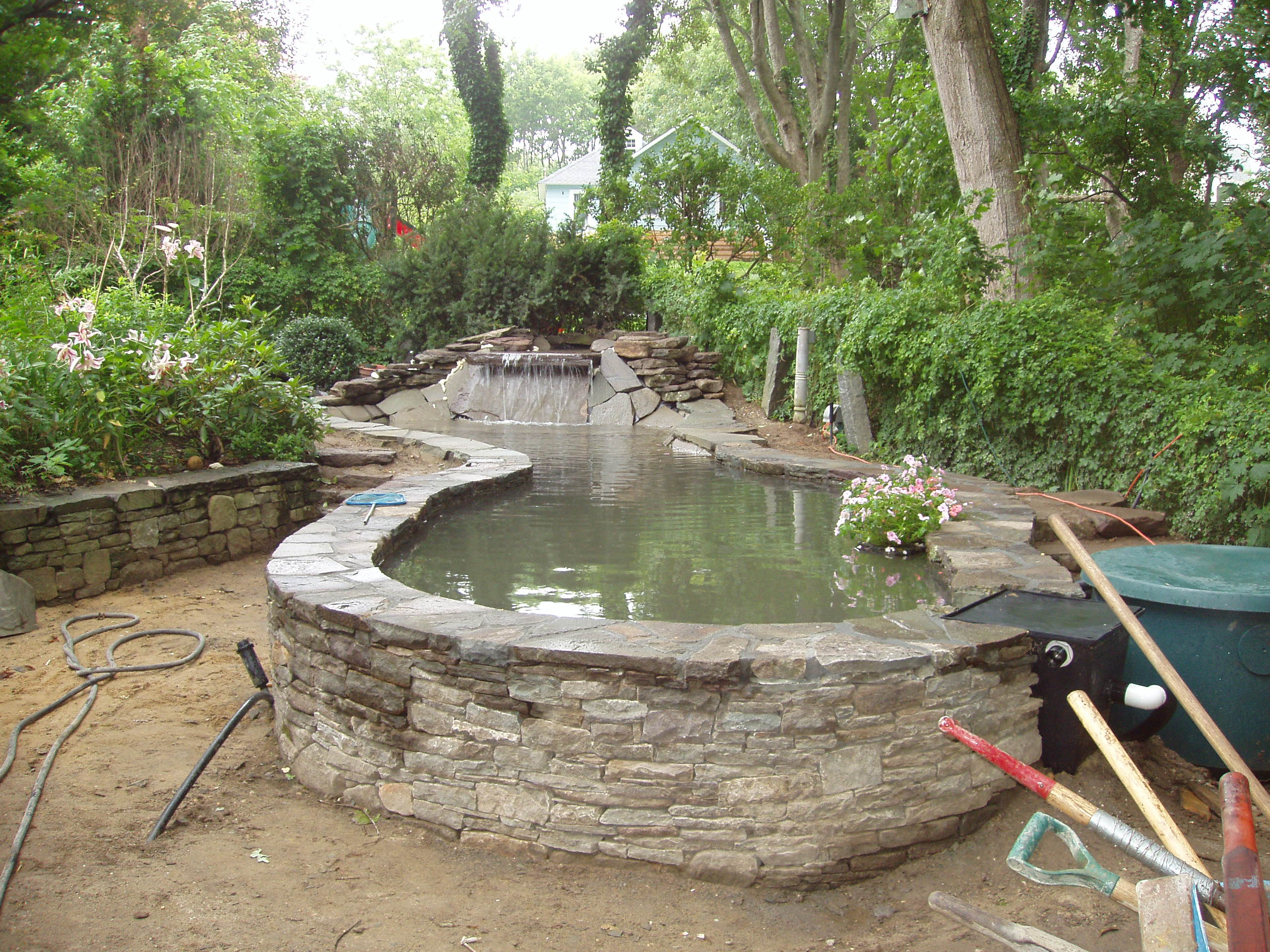 Above ground water gardens on pinterest koi ponds ponds for Stone koi pond