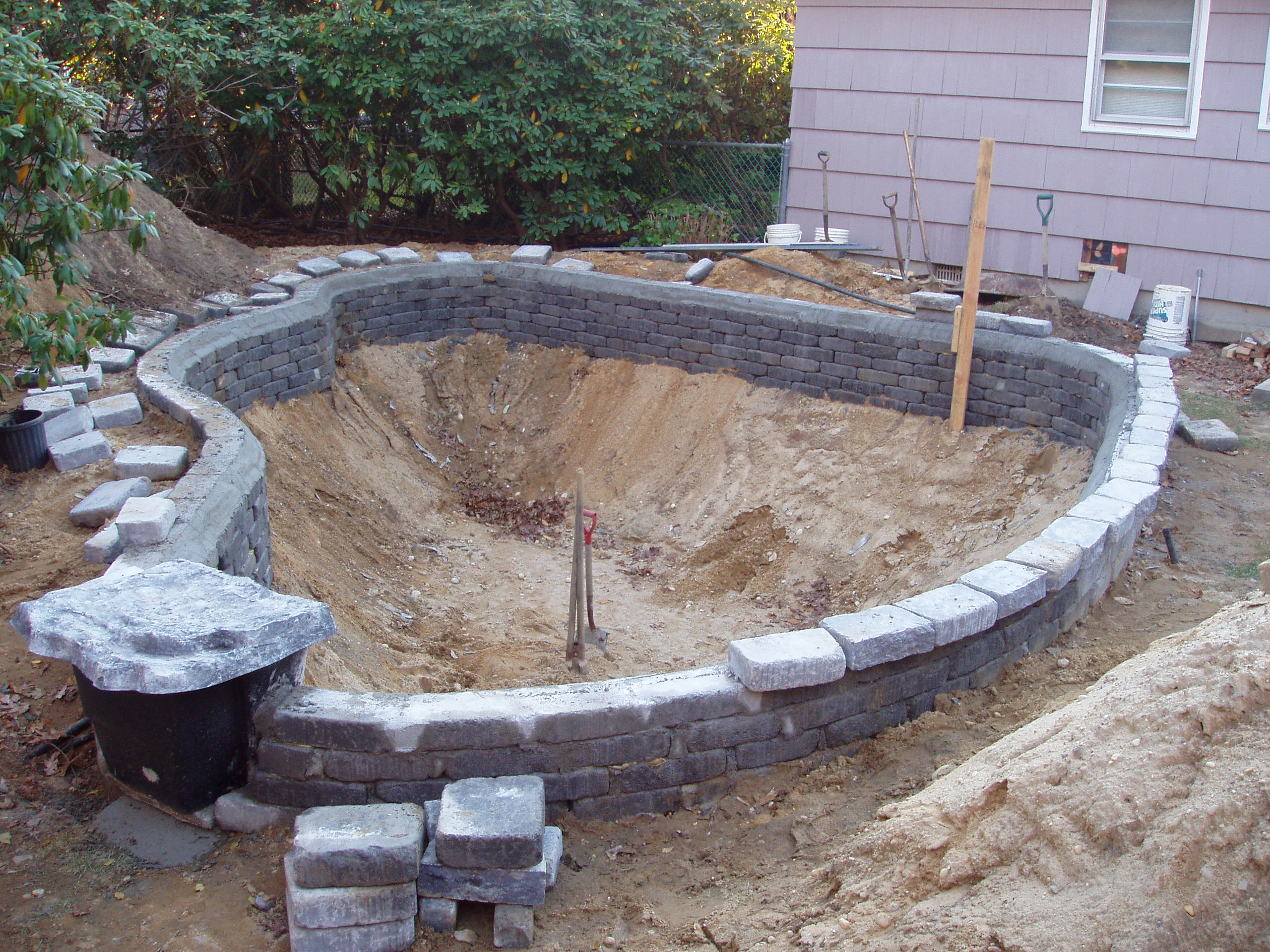 New pond construction for Concrete fish pond construction and design